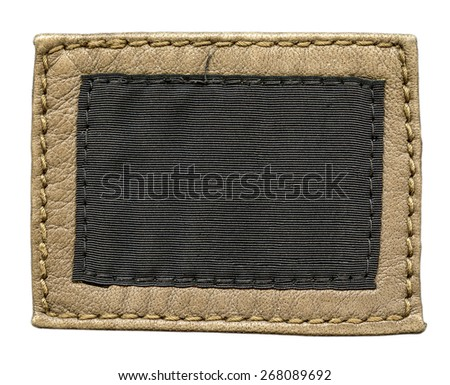 label of light brown leather and brown textile, pure label for your text. - stock photo