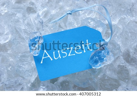 Label On Ice With Auszeit Means Downtime - stock photo