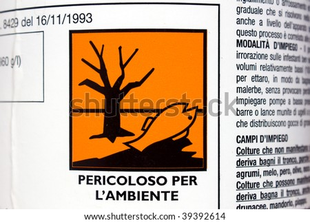 label on the bottle of product toxic and dangerous for environment, danger warning - stock photo