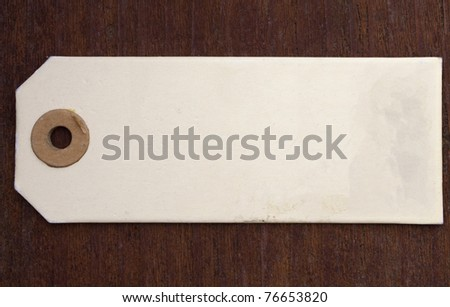 label over wooden background - stock photo