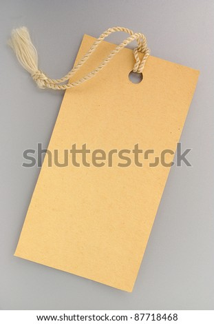 Label with a string on a gray background