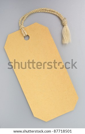 Label with a string on a gray background - stock photo