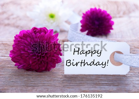 Label with Happy Birthday and Purple and White Flowers - stock photo