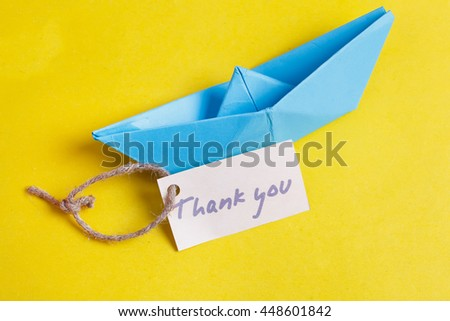Label with the Words Thank you. Paper Boat with a sign - stock photo