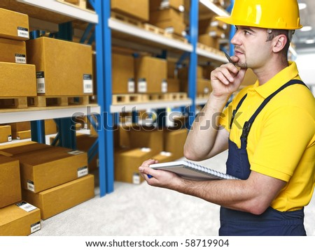 labor work and check parcel in warehouse - stock photo