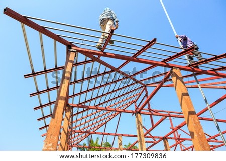 labor working in construction site for roof prepare
