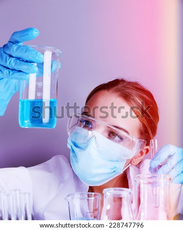Laboratory assistant making medical test in laboratory - stock photo