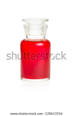 Laboratory bottle filled with red liquid - stock photo