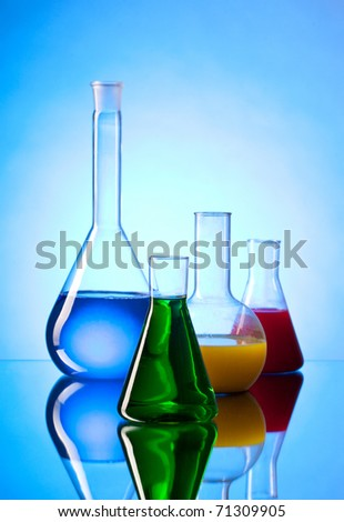 Laboratory bottles, each containing different color liquid.