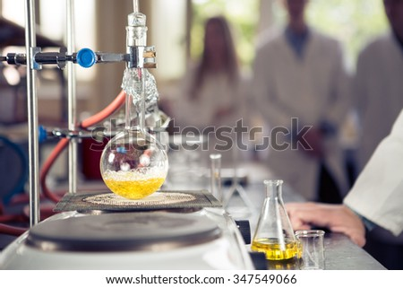 Laboratory equipment for distillation.Separating the component substances from liquid mixture with evaporation and condensation. Industrial chemistry. Pharmaceutical research. Erlemeyer flask, apparatus - stock photo