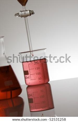 laboratory equipment with red liquid - stock photo