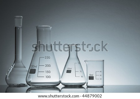 laboratory flasks and glass in shades of blue