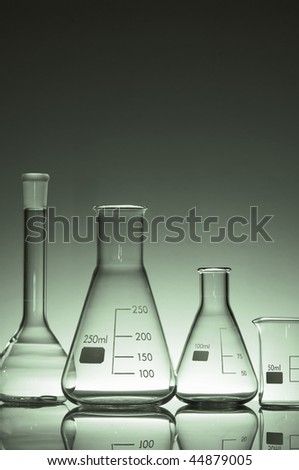 laboratory flasks and glass in shades of green