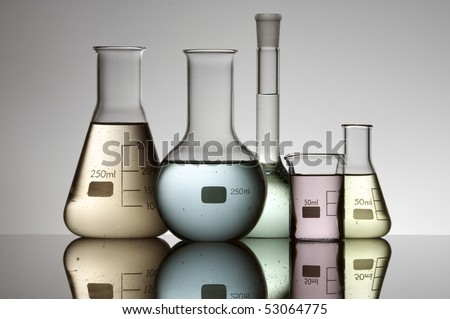 laboratory flasks group of brightly colored liquid and a white background