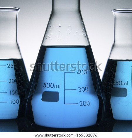 laboratory flasks with blue liquid inside - stock photo