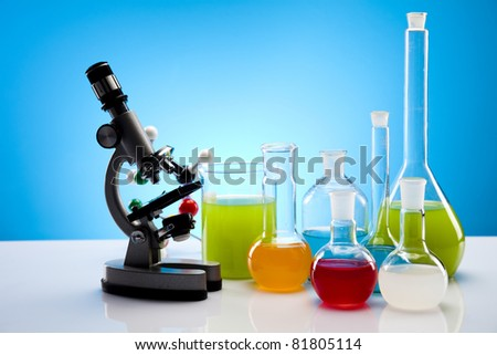 Laboratory flasks with fluids of different colors - stock photo