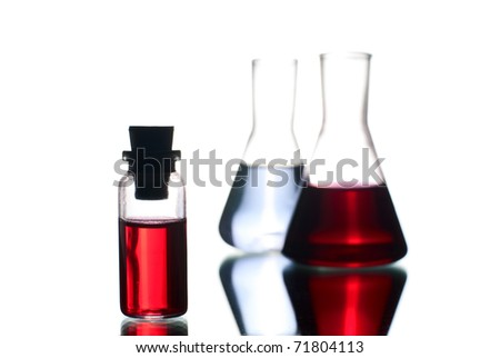 Laboratory flasks with liquid. White background. Studio shot. - stock photo