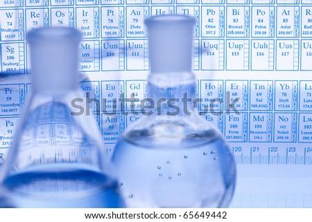 Laboratory glass, Beakers, Chemical formula - stock photo