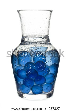 laboratory glass full of blue marbles and water - stock photo