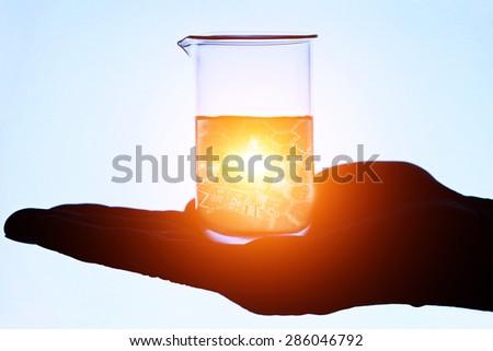 Laboratory glass on a arm. Laboratory concept.  - stock photo