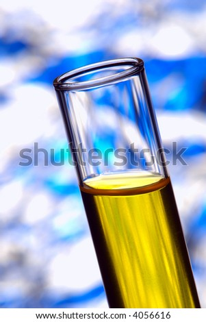 Laboratory glass test tube filled with yellow liquid for an experiment in a science research lab