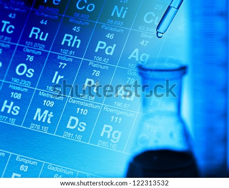 Laboratory glassware and arm with pipette - stock photo