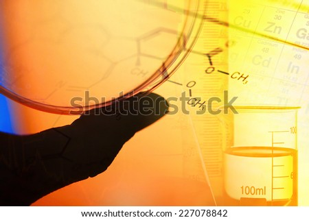 Laboratory glassware and periodic table of elements. Science concept - stock photo