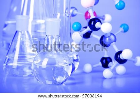 Laboratory glassware in blue light - stock photo