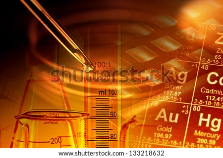 Laboratory glassware in yellow light with chemical formula. Science concept. - stock photo