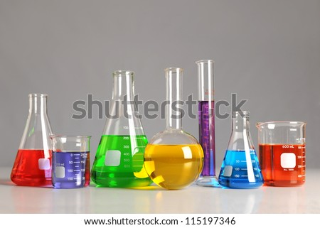 Laboratory glassware on table over neutral background -With Clipping Path - stock photo