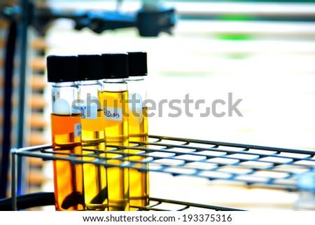 Laboratory glassware with chemical liquid - stock photo
