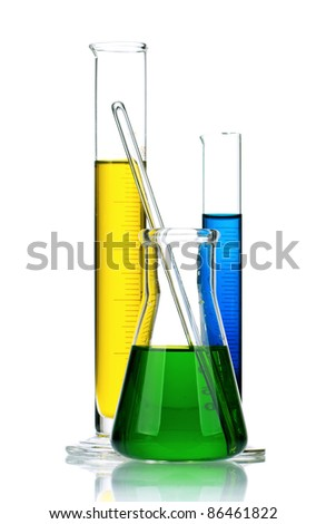 Laboratory glassware with colorful liquids on white background - stock photo