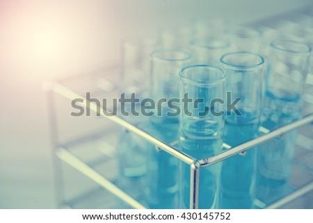 Laboratory glassware with liquid in blue tone - stock photo