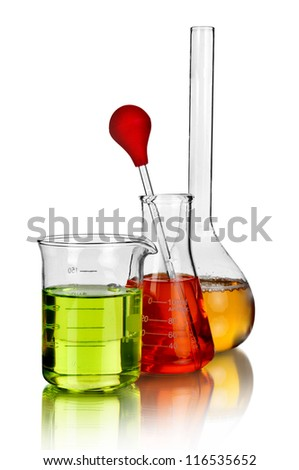 Laboratory glassware with reflections over white background - stock photo