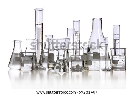 Laboratory glassware with transparent liquid isolated over white background - With clipping path - stock photo