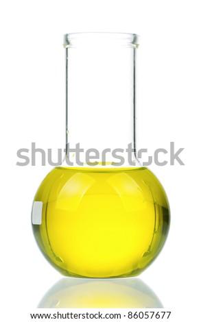 Laboratory glassware with yellow liquid on white background - stock photo