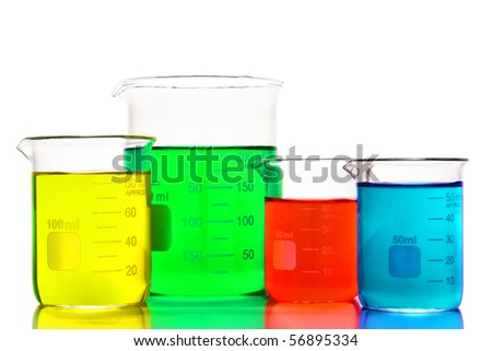 Laboratory graduated scientific beakers filled with colorful assorted colors liquids for an experiment in a science research lab - stock photo
