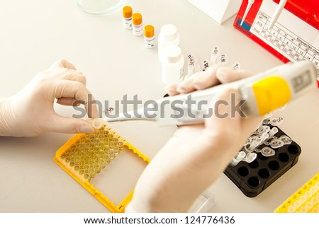 Laboratory of DNA research - stock photo
