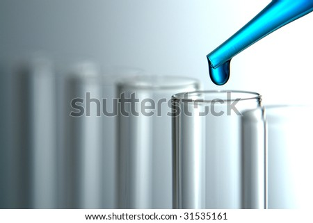 Laboratory pipette with drop of blue liquid chemical solution over empty glass test tubes for an experiment in a science research lab - stock photo