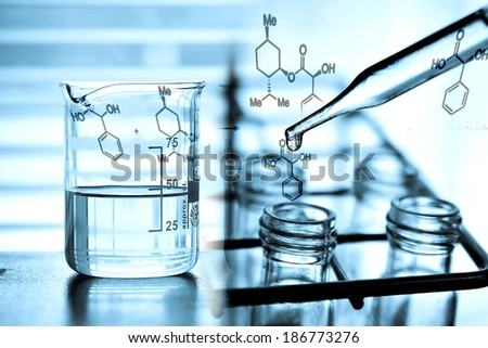 Laboratory Research, dropping chemical liquid to test tube with beaker - stock photo