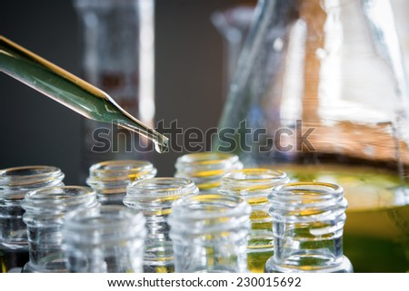 Laboratory research, dropping liquid to test tubes