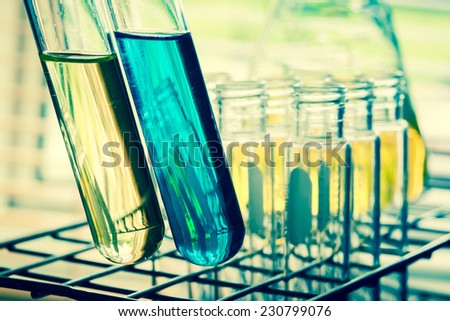 Laboratory research, Test tube with lab background  - stock photo