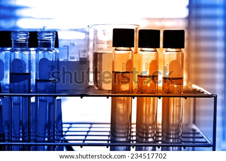 Laboratory research, test tubes in rack - stock photo