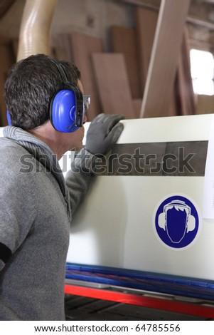 Laborer in workshop - stock photo