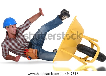 Laborer tumbling down from a barrow - stock photo