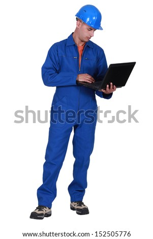 Laborer with computer - stock photo