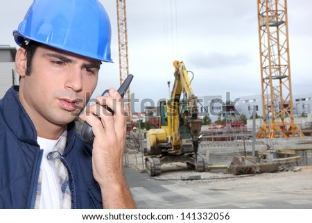 laborers communicationg with radio - stock photo