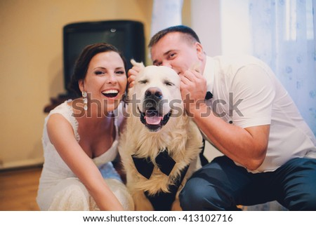 Labrador smiling while family playing with him, selective focus - stock photo