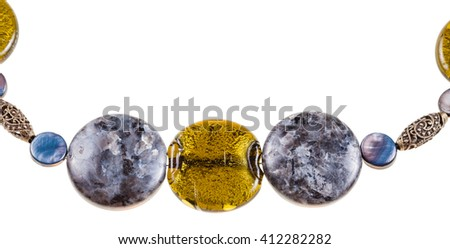 labradorite gemstone and colored glass beads in necklace close up isolated on white background
