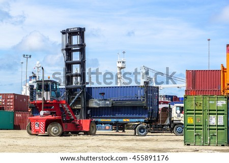 Labuan,Malaysia-July 21,2016:Forklift handling container box loading at the docks with truck at Labuan island portThe port has been managed by Labuan Liberty Port Management Sdn Bhd since 1988.